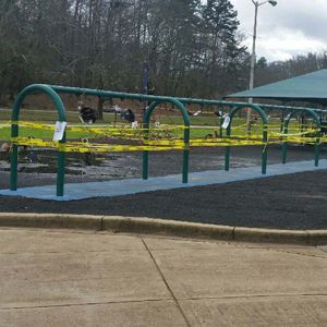 playground equipment with barricade tape to indicate it is out of service